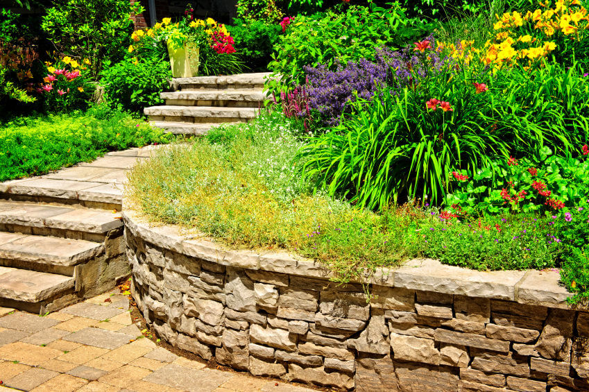 Landscaped rocks and stones add a natural element and would look great in your lush-colored outdoor flower garden, and can serve as the connecting piece to the outside world of concrete.