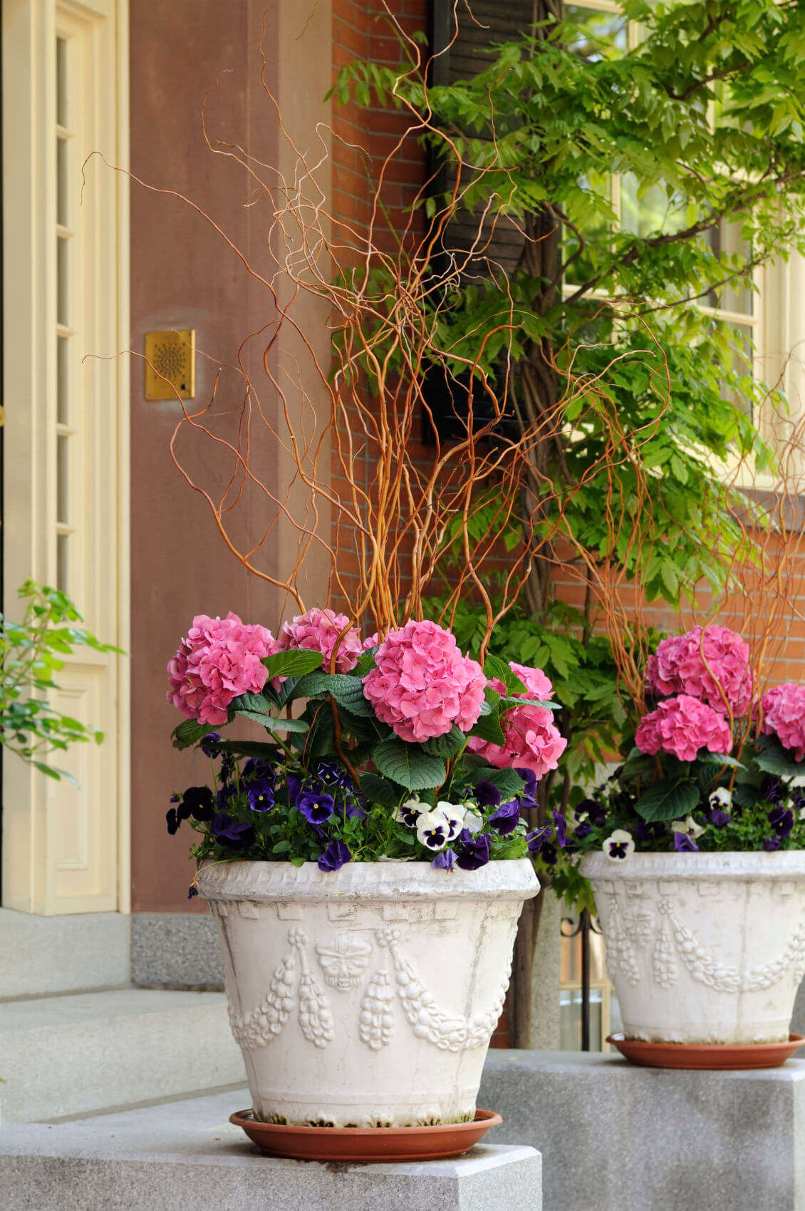 Give a royal feel to your ornate pottery arrangement by using pink  hydrangeas and arrange them