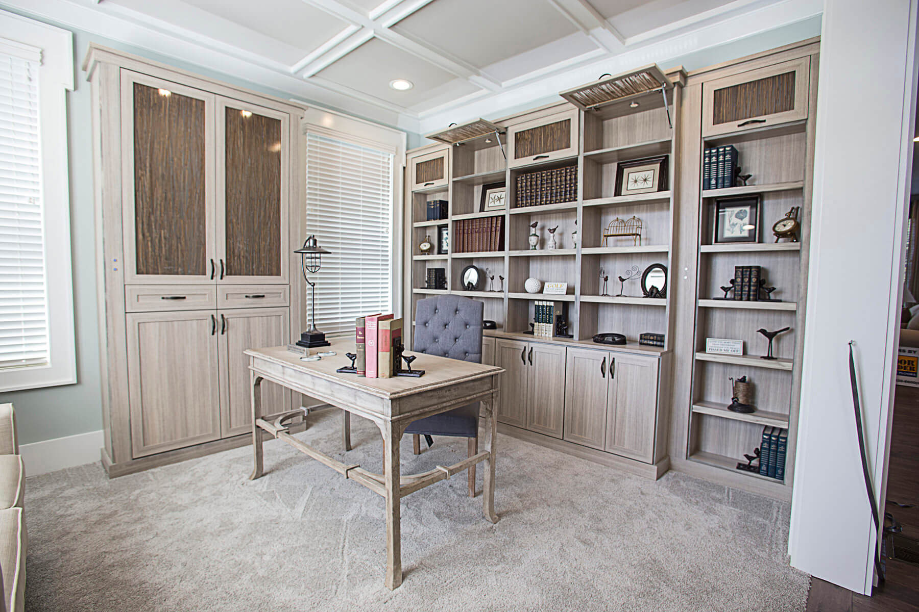 custom home office with built in storage and double sided desk