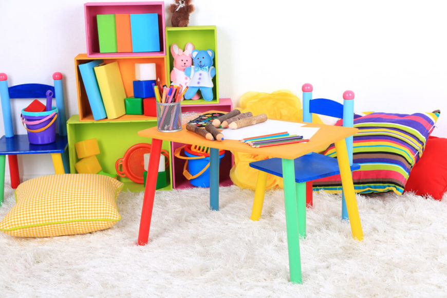 This brightly colored space is ideal for younger children. The bright colors and toys in the area will draw them in, where they can then be introduced to the books.