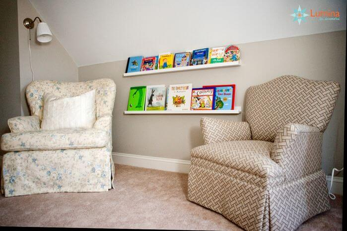 The books here are proudly on display on the shelves. This space has two cozy chairs for kids to sit by themselves or with adults if they are not yet able to read on their own.