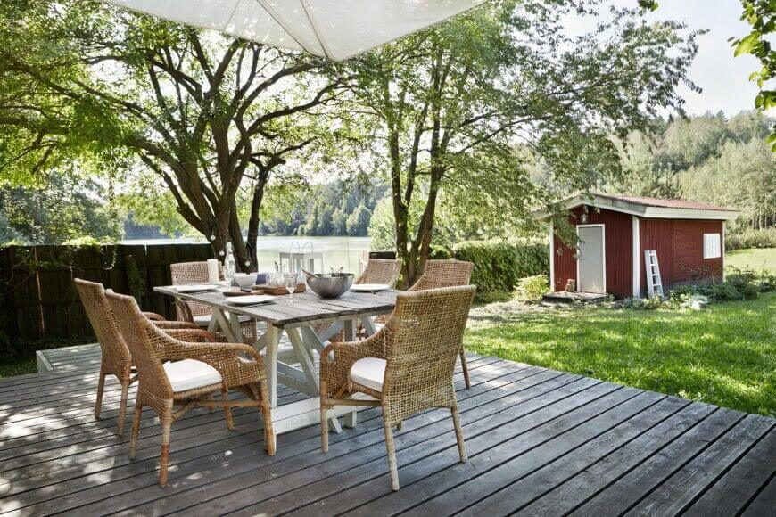 Faded Rustic Style Permeates This Floating Deck Perfectly In Line With The Farmhouse