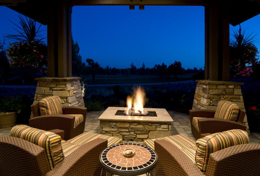 Square flagstone fire pit with flat top on patio with matching flagstones.