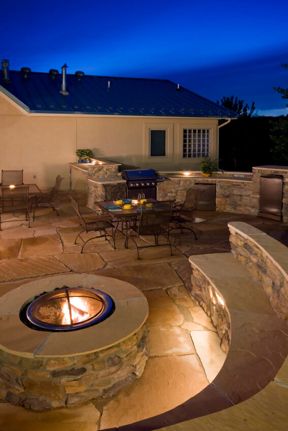 Round Brick Fire Pit With Flat Top And Dome Cover On Large Flagstone Patio Built