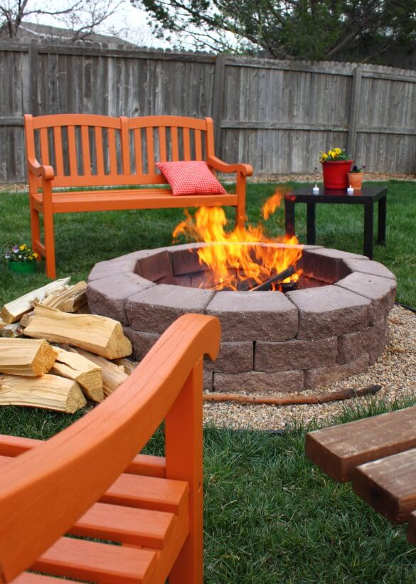 Round Brick Fire Pit Surrounded By A Row Of Tiny Gravel Built In The Middle  Of