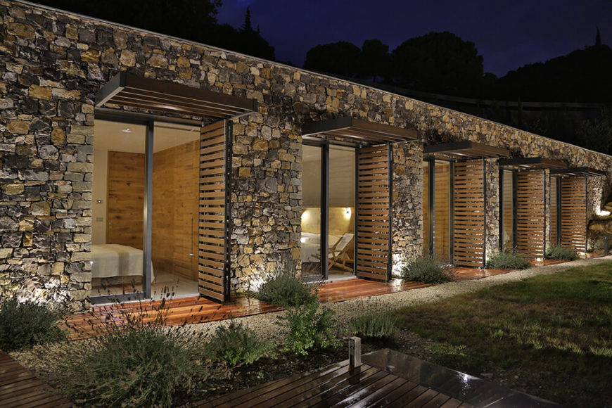 Along the bedroom side of the home, we can fully appreciate the rich stone facade covering the exterior. All of the stones were sourced on location during the initial excavation.