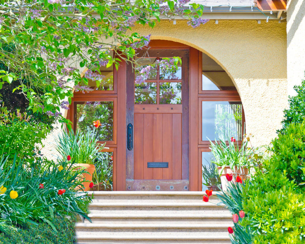 These door steps are flanked with green bushes and stunning blossoms of tulips and daffodils.  sc 1 st  Home Stratosphere & 59 Front Door Flower and Plant Ideas
