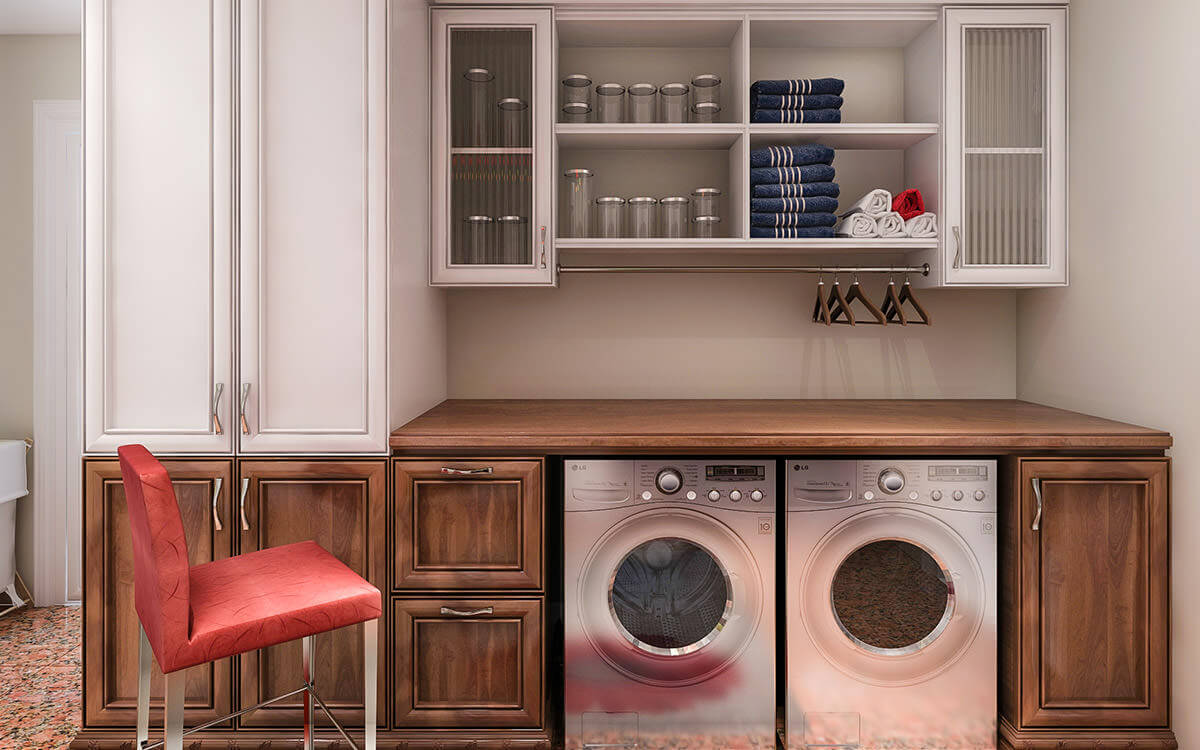 A small space has been utilized and maximized with very functional wood cabinets, storage shelves, a hanging rod and convenient working space on top of the washer and dryer machines.