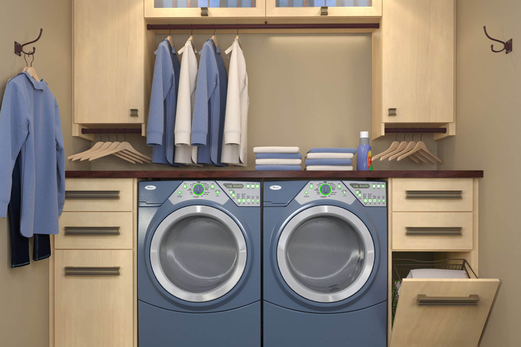 A small sized space is maximized with a functional laundry design such as tip out drawers with trays and two symmetrical wall hooks. This also has a few cabinet storage areas and hanger rods.