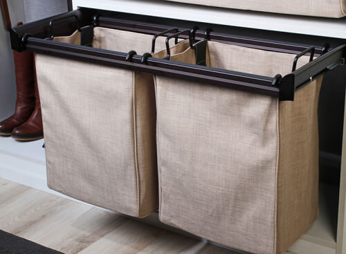 These are pull-out hampers with convenient handles for lifting out and sorting clothing.