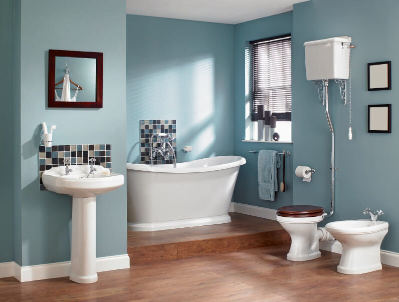 The bluish bathroom wall is accented with white sink, bathtub and bowls while the wood palette tiles give a contrasting cool look to the design.