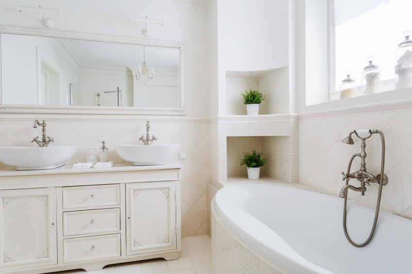 Pure white bathroom scheme. Everything is white at its finest, starting from the sink, top mount sink, tiles, vanities, floors and ceiling.