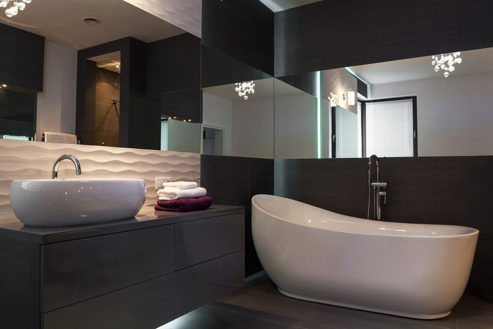 Black Wood Vanity And Walls Are Highlighted With White Sink And Bath Tub  And Accented By