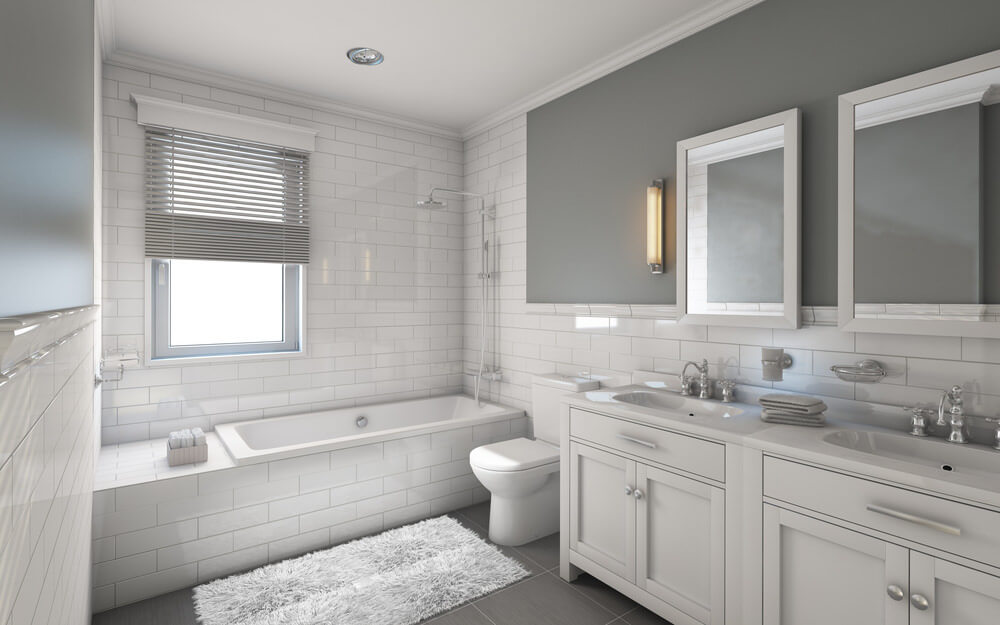 Shades of grey hype out this bathroom color scheme. Given the dark grey tiles and wall, the white vanities and brick wall, the cool drama of this room keeps rolling.