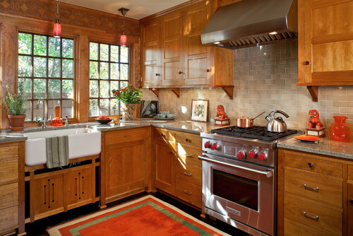 Mission style is a sub-style of Craftsman, and tends to be somewhat more Southwestern inspired, which we can see in the woodwork above the windows and on the cabinet doors beneath the farmhouse sink.