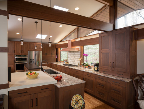 The open feel of this Craftsman kitchen is inspired by contemporary design, but the handcrafted details and organic materials are rooted in more traditional Craftsman styles.