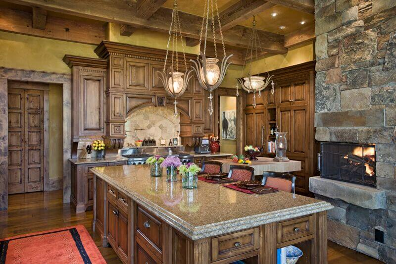 This kitchen really hinges on the very edge of Craftsman, since it features ornate cabinetry that doesn't quite fit with the Craftsman aesthetic. However, it still features all the natural, handcrafted elements that make it Craftsman.