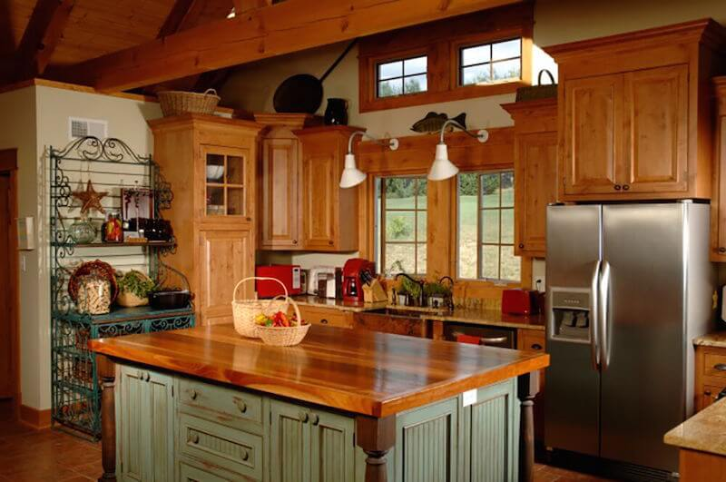 This is another great example of how to add non-organic color to a Craftsman kitchen. The distressed, dusky green on the island and in the baker's rack is subtle, yet adds brightness and contrast to the light maple cabinets.