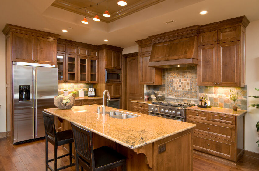 This Lovely Craftsman Kitchen Features A Deep Tray Ceiling, Simply Carved  Natural Wood Cabinetry,