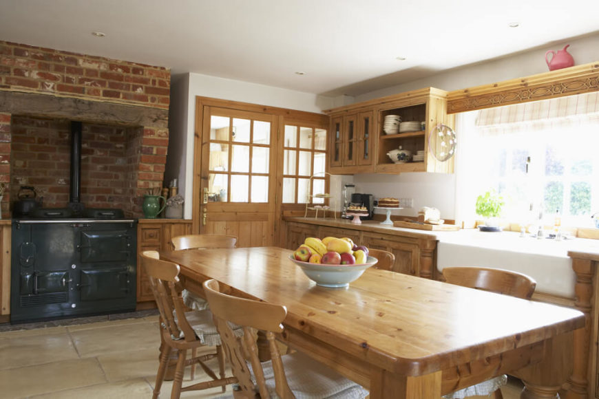 Vintage appliances and the light pinewood details of this kitchen make it somewhat less contemporary than other kitchens in this collection. This is a lovely kitchen, with plenty of windows to bring in light and fresh air.