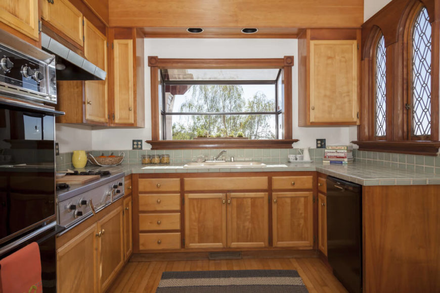 Craftsman style is known for the incredible windows, and this kitchen has several types. The extended window above the sink is like a mini greenhouse for an herb garden, while the more decorative windows to the right let in light without sacrificing privacy.