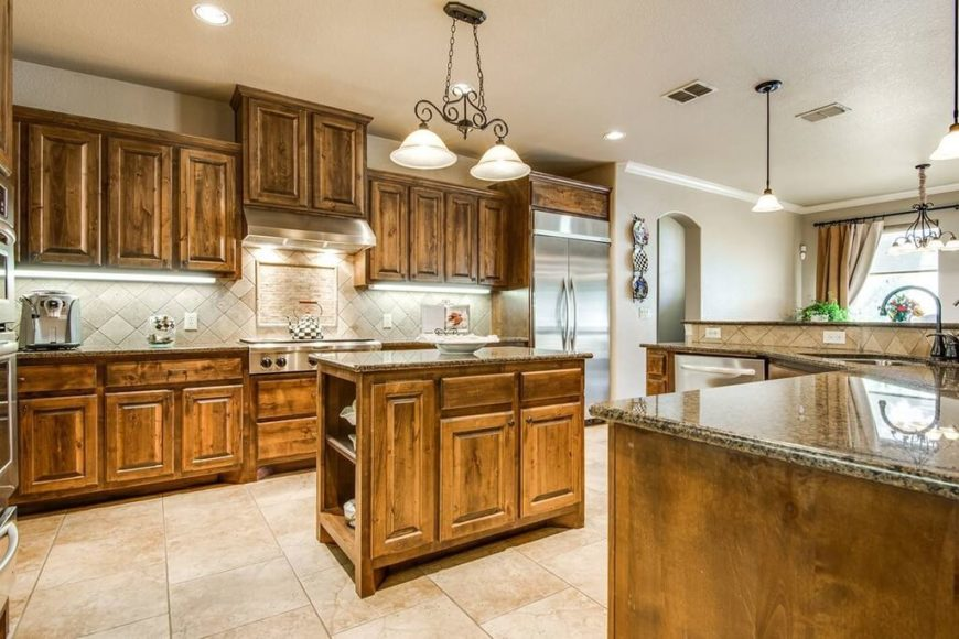 It can be difficult to create a fully Craftsman style, which is a great reason to show you kitchens that have a few details that don't quite fit the Craftsman by-the-book style. Here, we see the light fixtures, which are a little ornate for Craftsman style.