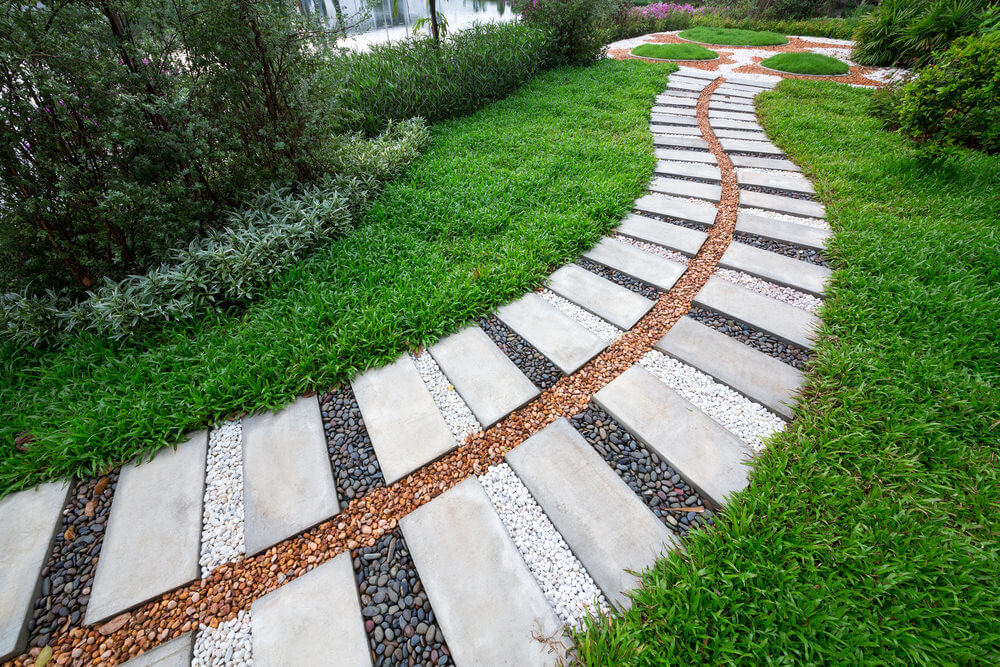 A contemporary designed paver and gravel pathway looks as simple as this picture shows.