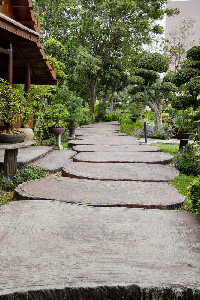 these stepping stones are designed as large wood cut pavers they create a natural look - Garden Path Ideas