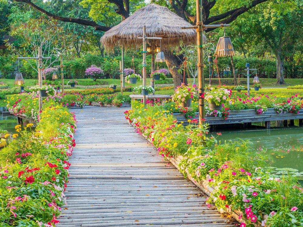 This pathway is more inclined with nature as it features bamboo poles organized into a pathway that is heading to a native gazebo.