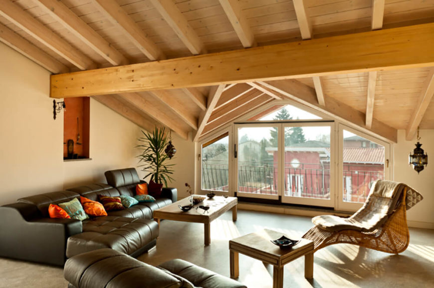 Here, The Lighter Pine Beams Support The Vaulted Roof Of This Attic Family  Room.