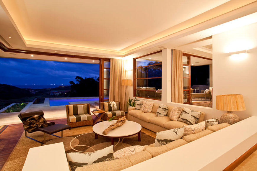 The living room is wrapped by a huge sectional on the inside, and massive wrap around sliding glass panels on the exterior side. This allows the room to open completely to the vast patio and outdoors.