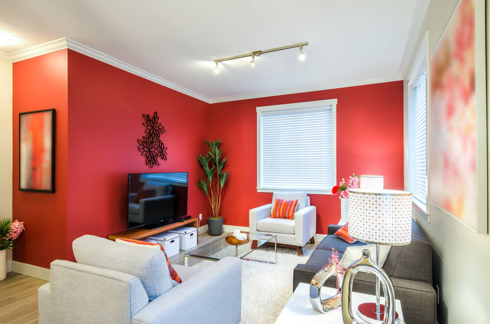 Give life and light in your living room by combining rich shade of reds or orange on the walls with lighter shades of grey for your ceiling and furnishings. These colors would light up your conversations quite well, and still relax you as you bond with family and friends.