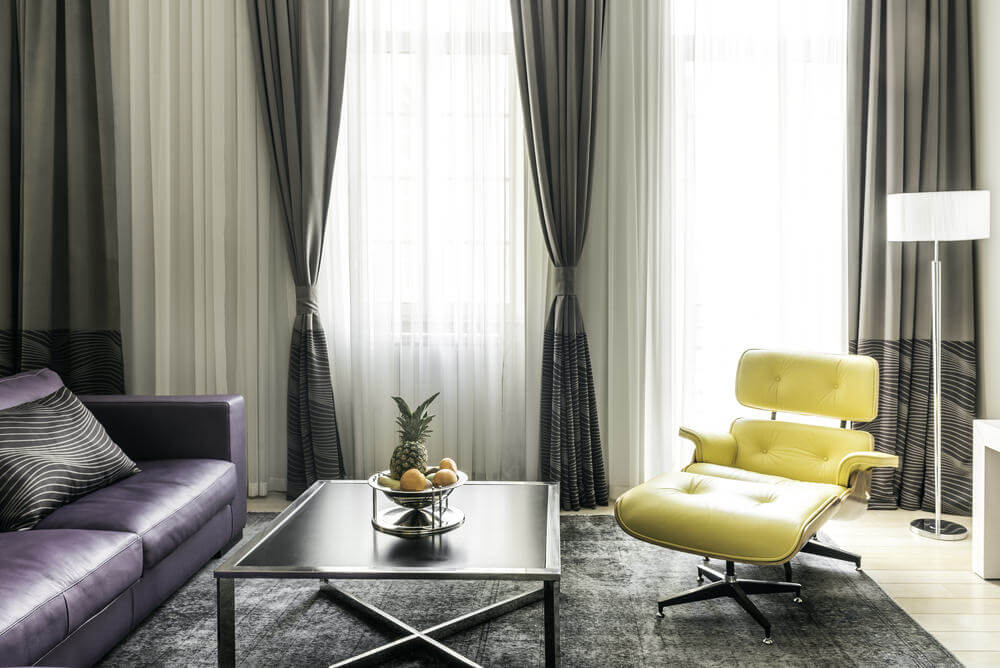 If you have a lot of natural lighting, accentuate it with white or grey wall paint to allow more light to flow in the room. Highlight key areas in your room with rich colors such as lush violet furnishings, dark grey/black curtains and something vibrant like a light yellow furnishing.