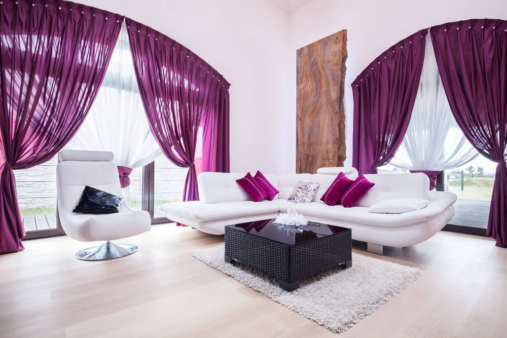 Combine light grey/white walls with violet accents to make your room as regal as you want to feel when you get home. Not only do these colors supplement the calming effect of violet, but it also gives a clean and elegant feel to your living room.
