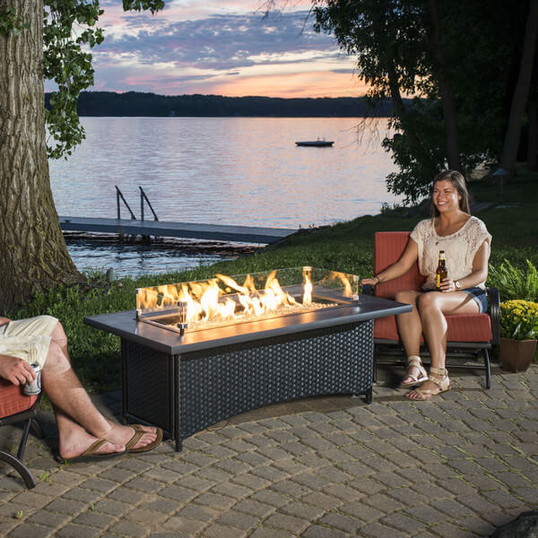 Want to confuse your guest into assuming your fire pit is a regular outdoor wicker coffee table? Then get this rectangle patio propane fire pit. This fire pit is good for six to eight people and the glass frame would allow you to use the rest of the table as a coffee table and stay safe away from the heat.