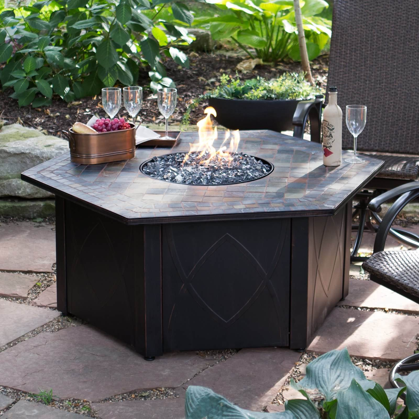 Want a campfire in a most unusual way? Get this hexagon shaped patio propane fire pit for your home. This fire pit can wow the crowd and give you all the access you need for your drinks, supplies and others. It has a 30,000 BTU burner capacity and it is weatherproof! It comes with its own fire pit cover to protect your fire pit.