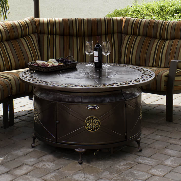 Want a fire pit that you can convert into a table when not in use? Try this aluminum patio propane fire pit. You can adjust the fire pit itself and it has a heat output of 42,000 BTUs. It also comes with its own fire glass and you can keep the propane tank on its base.