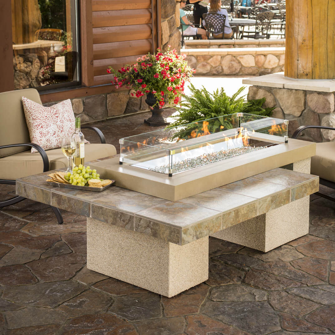 Get this beautiful stainless steel crystal propane fire pit that looks like a granite tile table that would fit in your home. You can adjust the flame height easily and it has a heat capacity of 65,000 BTUs. You can even convert the table you use for this fire pit if you wish.