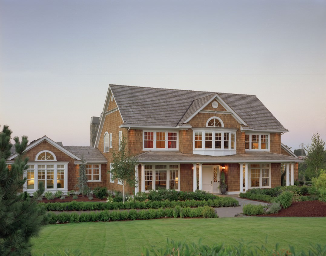 Here you have more of a traditional shingle style home, beautiful yet simple and pristine. With a home this lovely, it is important that you maintain curb appeal by keeping the landscaping just as beautiful as the home itself.