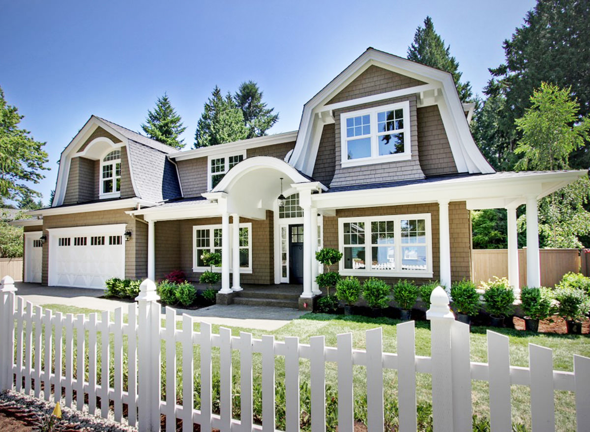 This is the home that one only dreams of owning, with its white picket fence. The white accent around the homes exterior makes it stand out.