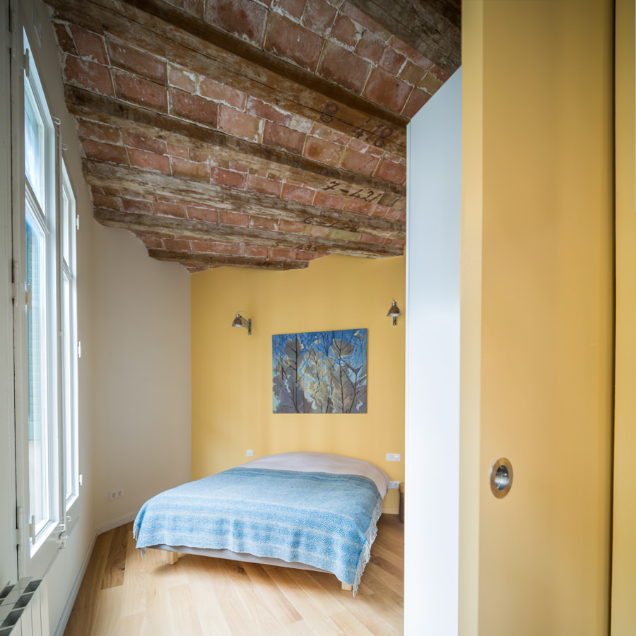 The chamfered ceiling is indeed a fascination to this house. The bedroom is designed at its most modest way showcasing a simple and neat space.