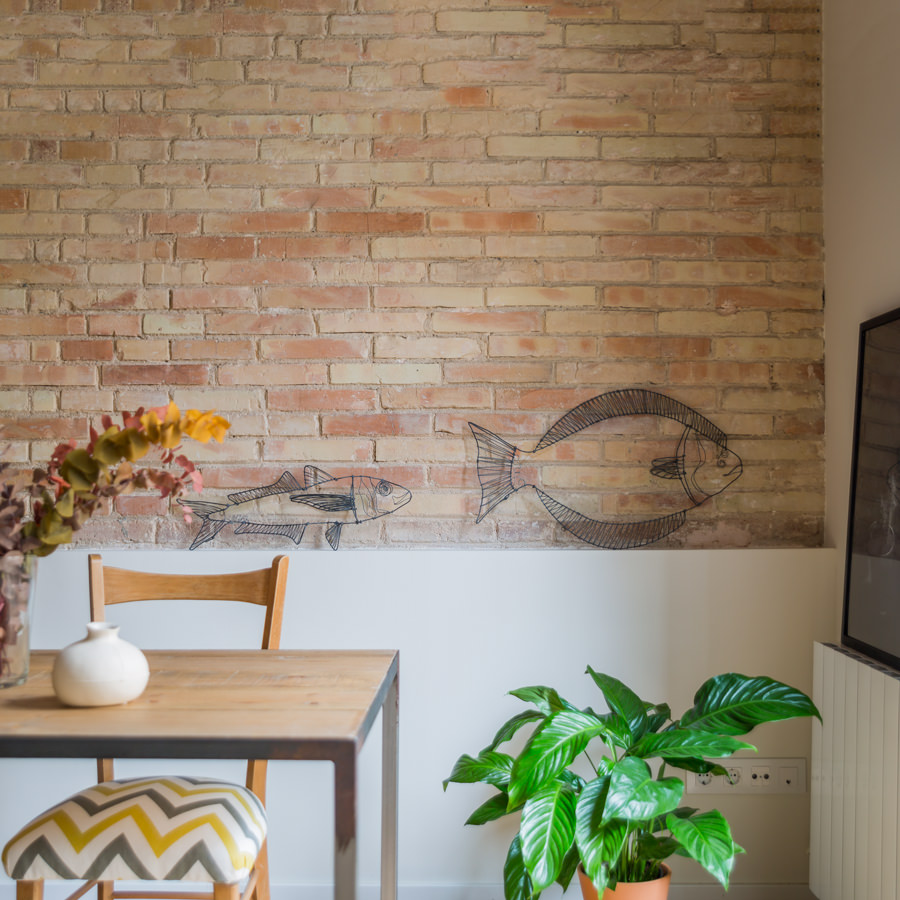 The rustic brick stone walling turned out cute and fun with the fish form sketches on them.