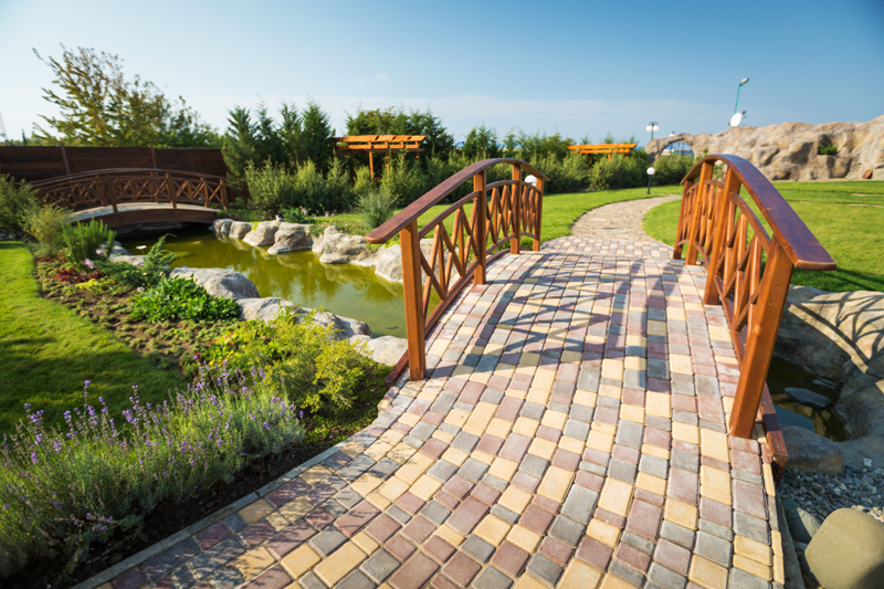 Gorgeous brick bridge over a pond winding its way around the property line.