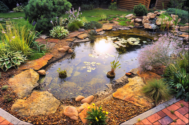 This pond, surrounded by orange and yellow toned bricks and rocks is an inviting spot. Bring your favorite garden chair and a good book to enjoy.