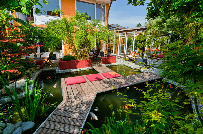 35 backyard pond images great landscaping ideas for Landscaping around koi pond