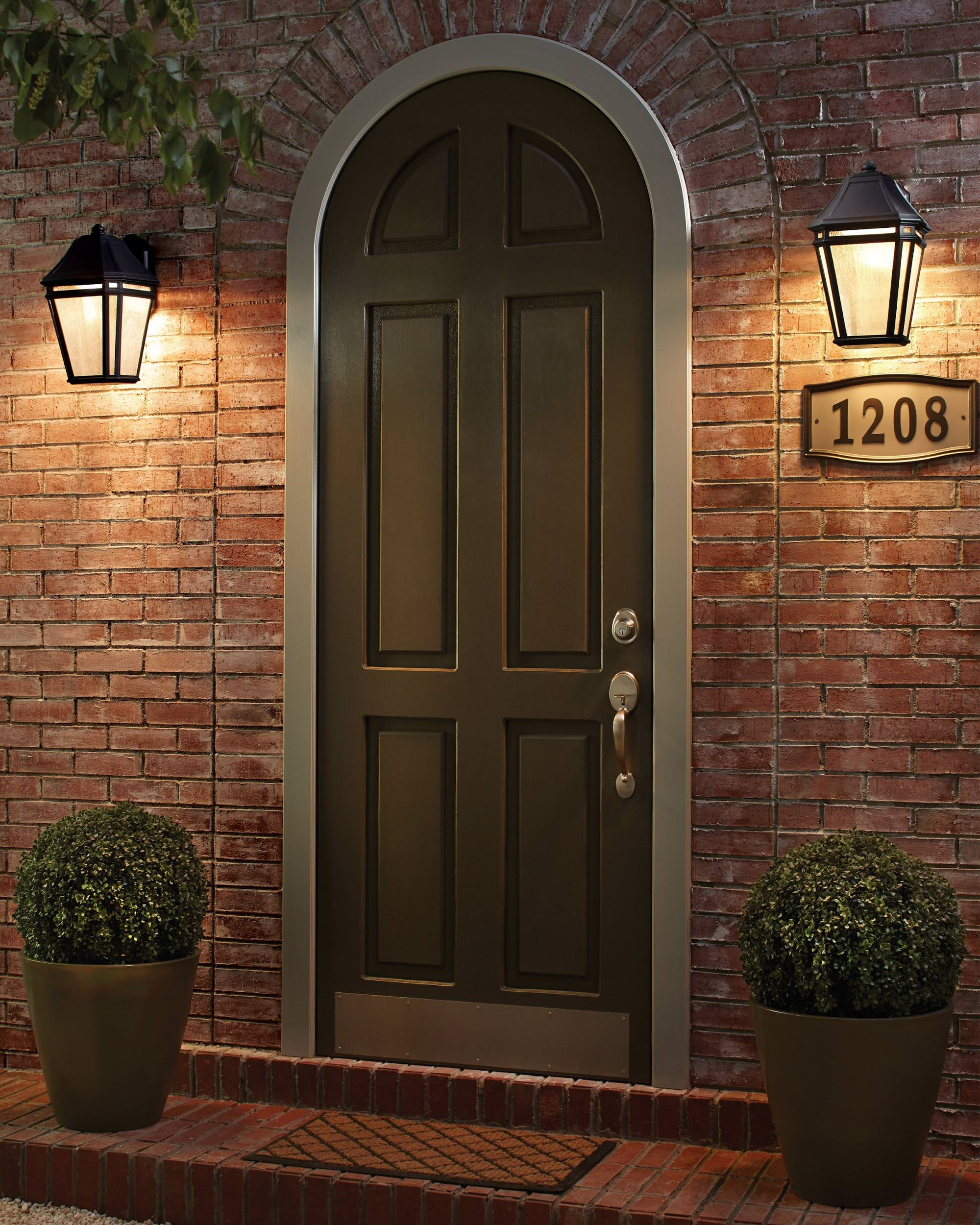 Front Door With Two Wall Mounted Lights.