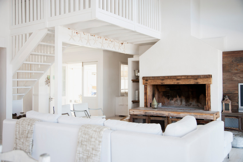 Wood plank walls and fireplace accent the white overall tone of the area.