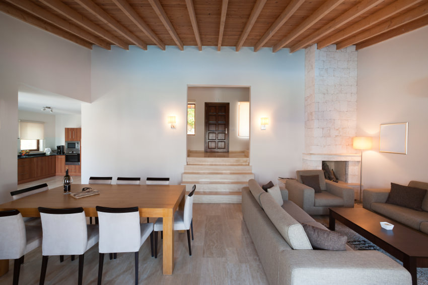 A modern touch in Mediterranean design where beams and ceiling give  contrast to the neutral color