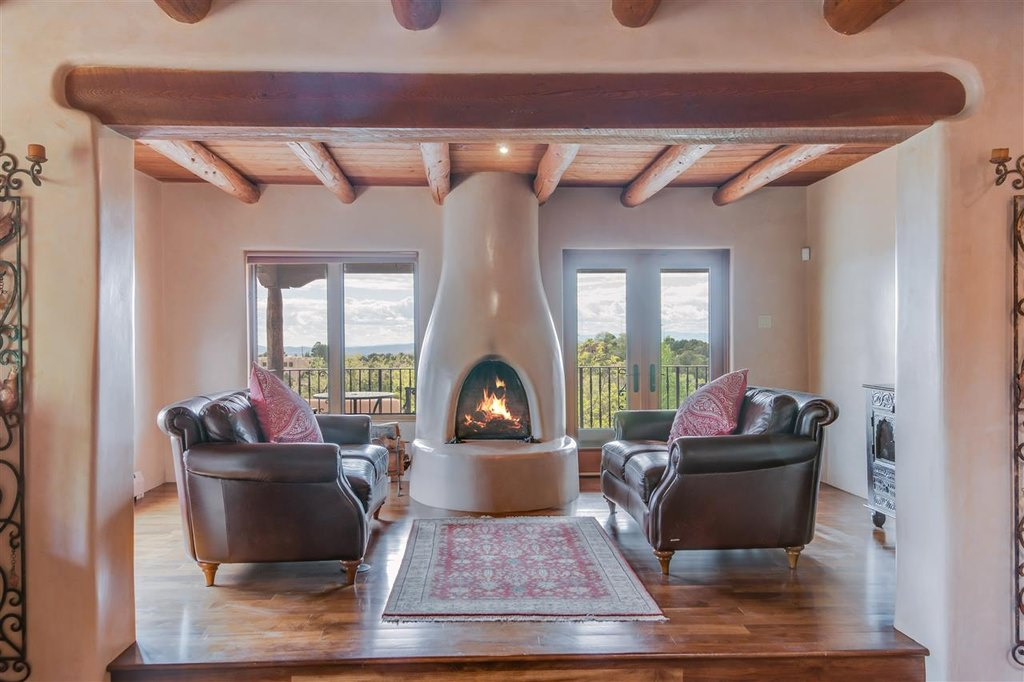 Southwester interior with fireplace and wood-beamed ceilings.