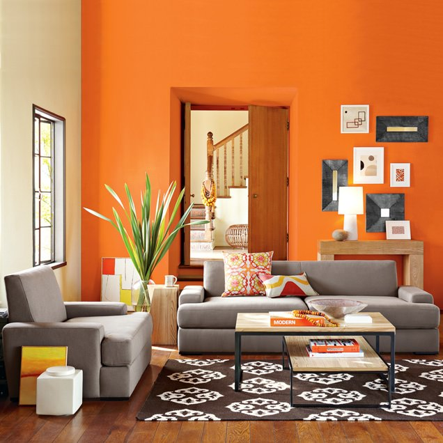 This Living Room Is Brightened By Both The Daylight And The Wall Painted In  Bright Orange